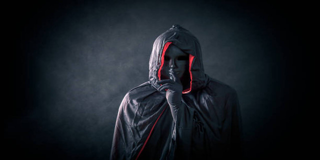 Scary-figure-with-black-mask-in-hooded-cloak.jpg