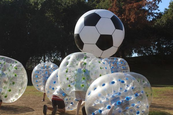 Bubble Balls in action with a giant 6ft Soccer Ball, variation of Bubble Soccer provided by AirballingLA