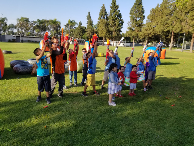 kids enjoying ther nerf gun party at orange County on May 4th