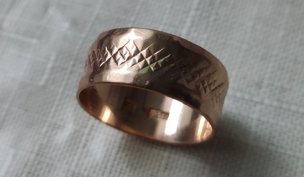 Refined gold ring.