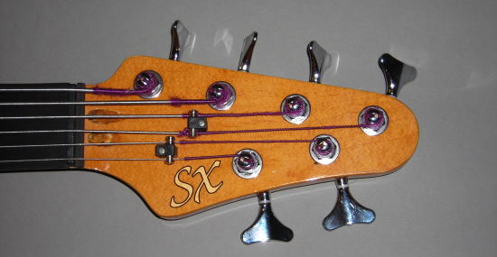 SX com headstock tipo Fender Sx3