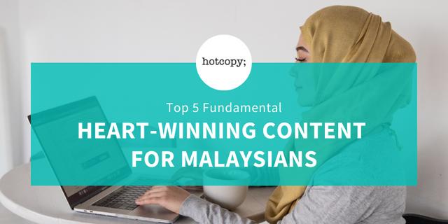 Muslim businesswoman typing on laptop - Hotcopy