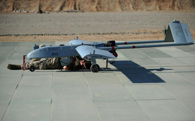 A-US-Marine-inspects-an-unmanned-aerial-vehicle-UAV-at-Vehicle-Squadron-2-Camp-Dwyer-in-Gamser-Helma