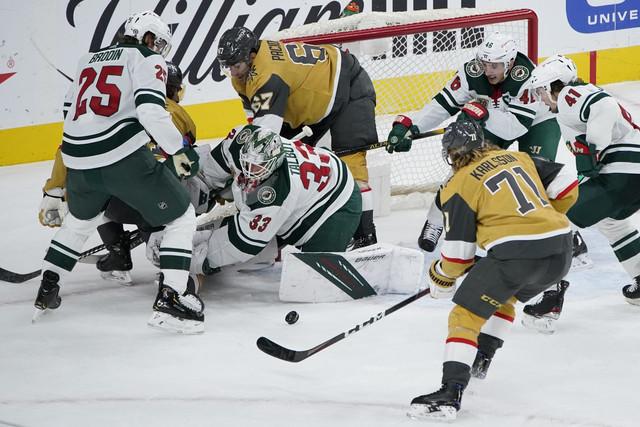 Apr-3-2021-Las-Vegas-Nevada-USA-Minnesota-Wild-goaltender-Cam-Talbot-33-makes-a-save-against-the-Veg