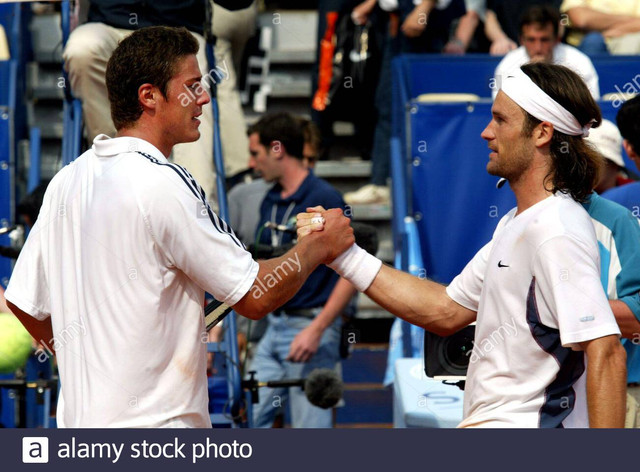 carlos-moya-of-spain-shakes-hands-with-marat-safin-of-russia-after-victory-in-the-quarterfinals-of-t