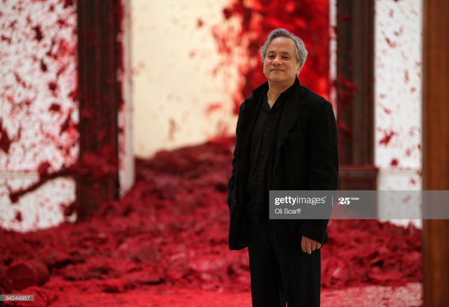 LONDON-ENGLAND-DECEMBER-10-Sculptor-Anish-Kapoor-poses-for-photographs-in-front-of-his-artwork-Shoot.jpg