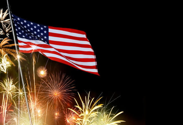 American-Flag-Infront-Of-Fireworks-i-Stock-000042103090-Small