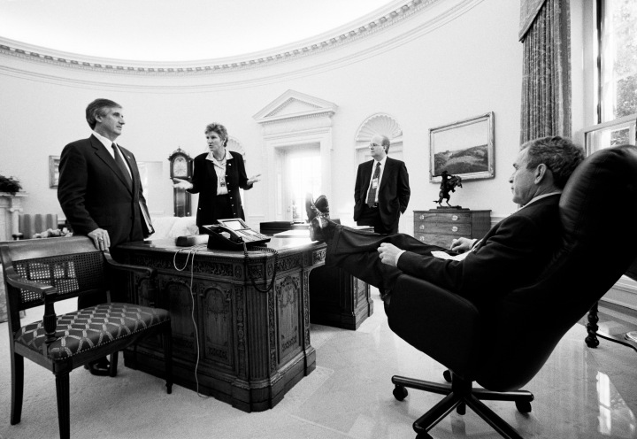 President-George-W-Bush-meets-with-senior-staff-in-the-Oval-Office-to-discuss-policy-Left-to-right-C
