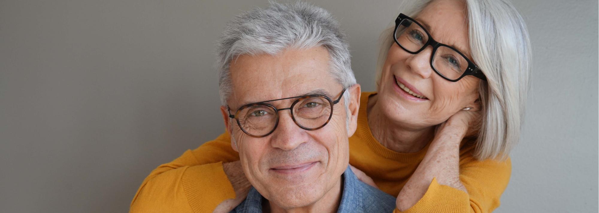 happy couple wearing glasses