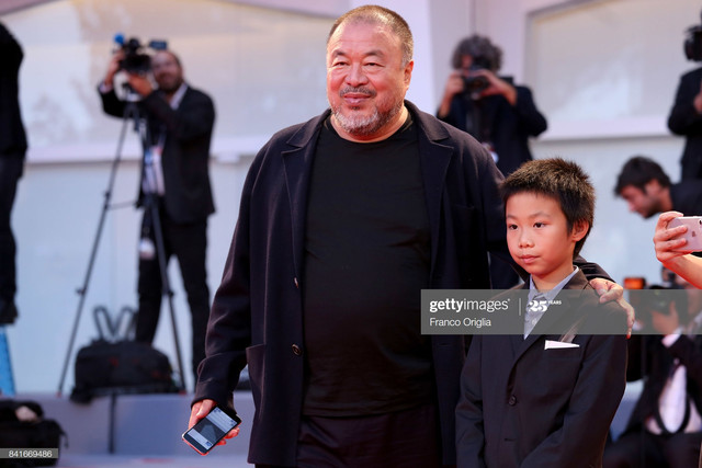 VENICE-ITALY-SEPTEMBER-01-Ai-Weiwei-and-his-son-Lao-Ai-walk-the-red-carpet-ahead-of-the-Human-Flow-s.jpg