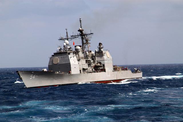030328 N 6264 H 001 East China Sea Mar 28 2003 The missile guided cruiser USS Antietam CG 54 rolls t