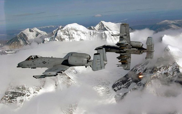 A-10-Thunderbolt-IIs-break-over-the-Pacific-Alaska-Range-Complex-and-one-aircraft-drops-a-flare-duri