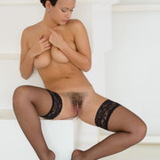 busty-pammie-lee-looks-as-hot-as-ever-while-posing-in-black-laced-lingerie-and-black-stockings-12
