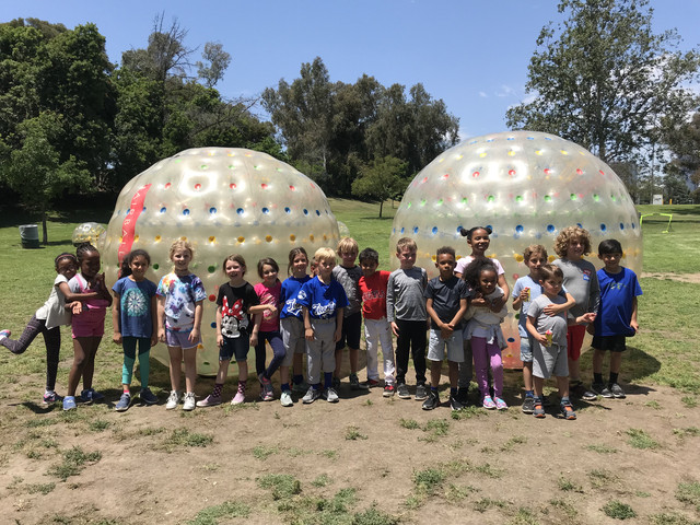 Children next to Giant Zorb Balls and ready to play Bubble Soccer on May 11