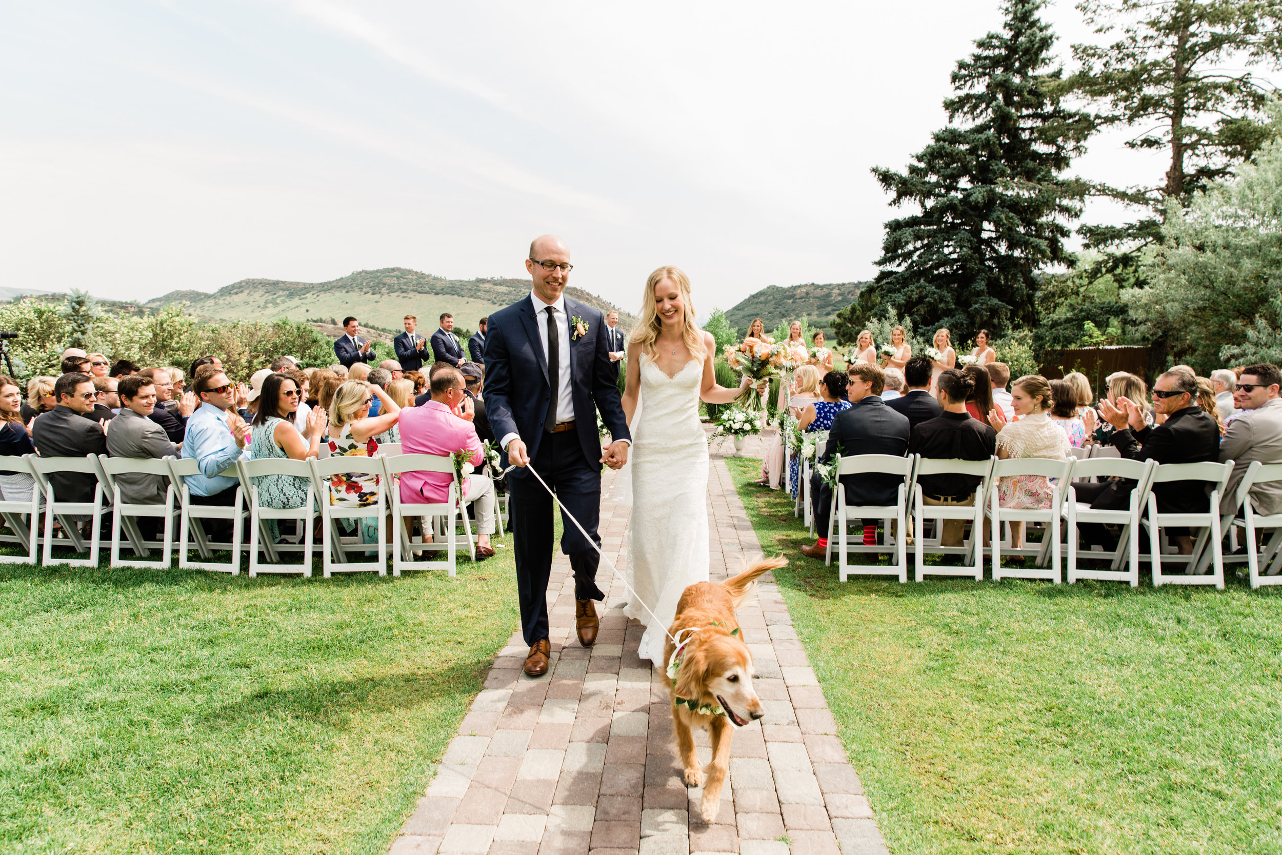 Couple walk dog down the aisle