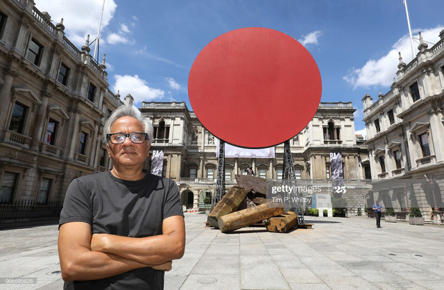 LONDON-ENGLAND-JUNE-03-Royal-Academician-Sir-Anish-Kapoor-with-his-monumental-work-Symphony-for-a-Be.jpg