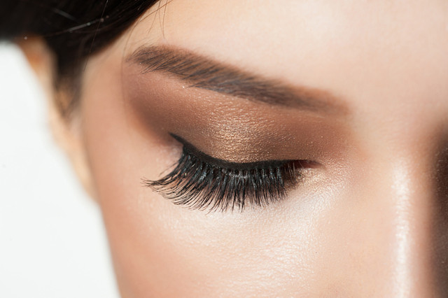 Closeup-image-of-closed-woman-eyes-with-beautiful-bright-makeup-Makeup-with-eyeliner-and-falce-eyela