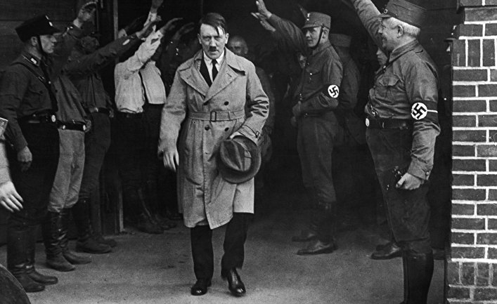 Hitler surrounded by associates.