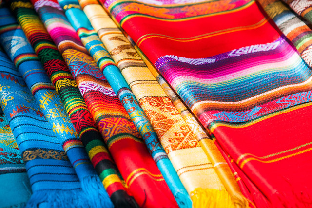 Canva-Colorful-Mexican-serapes-hang-in-row-min.jpg