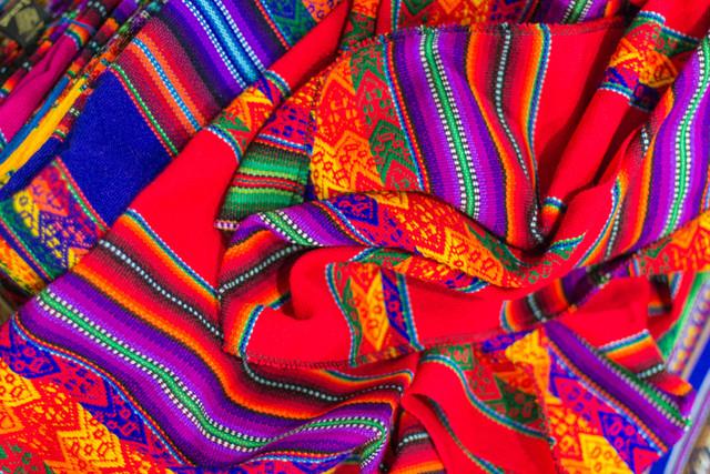 Canva-Colorful-Fabric-at-market-in-Peru-South-America-min.jpg