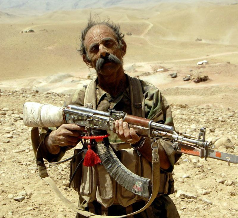 Afghan soldier with AK 47 assault rifle