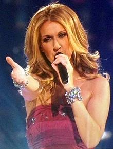 220px-Celine-Dion-Concert-Singing-Taking-Chances-2008.png