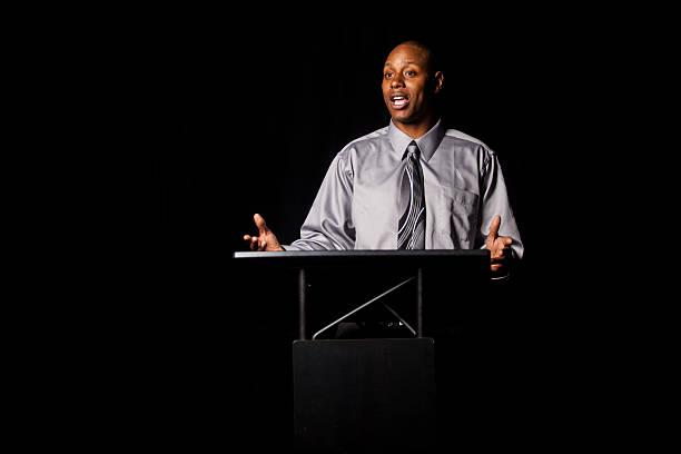 African-American-man-giving-a-speech-at-a-podium.jpg