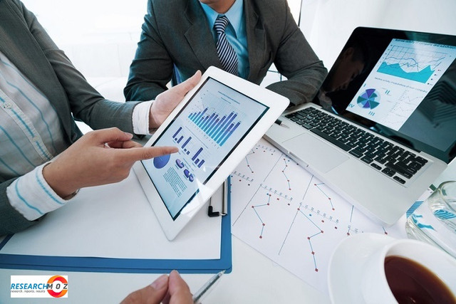Group-of-executives-discussing-business-activity-graphs-on-tablet-screen.jpg