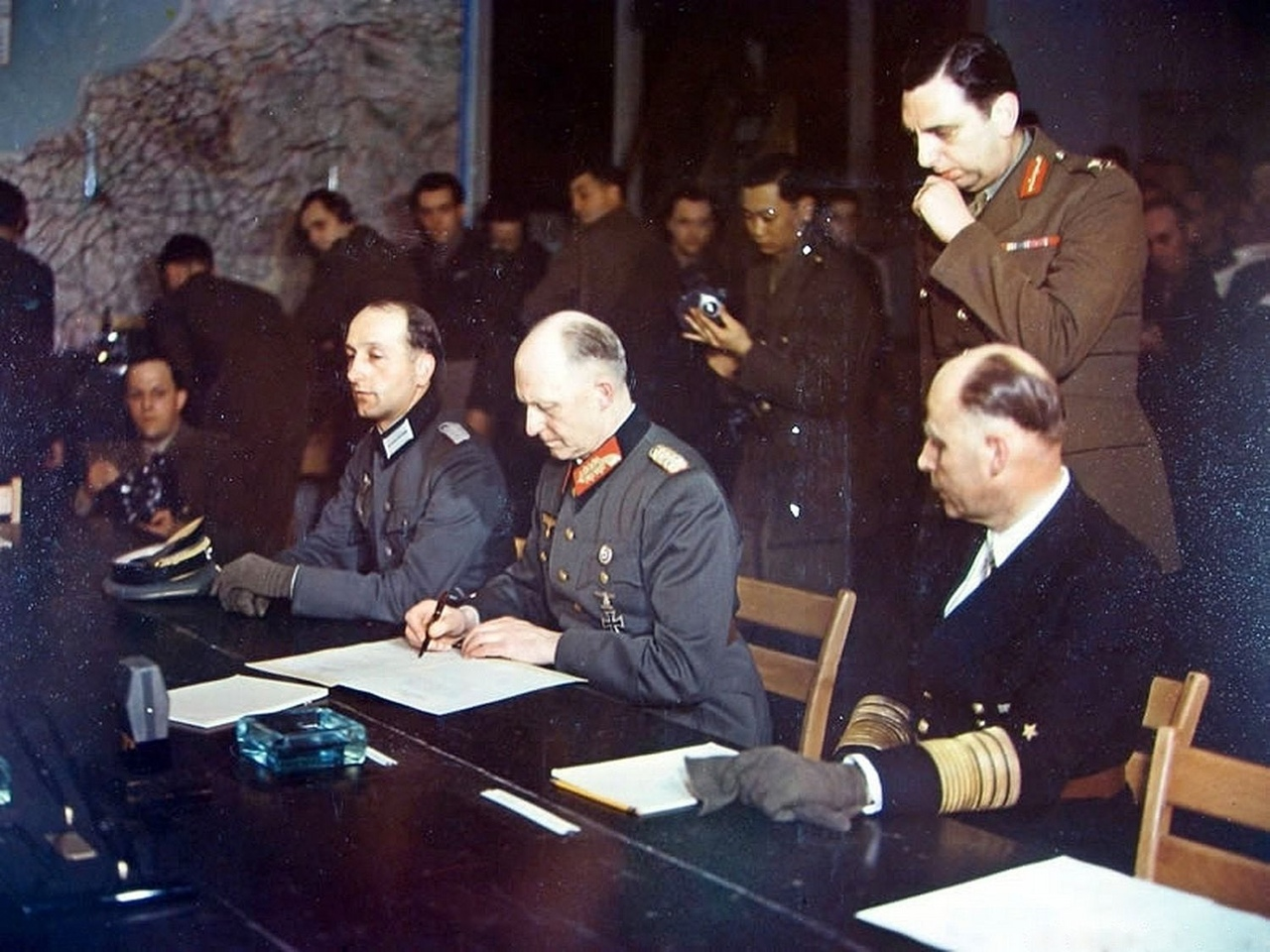 The face of German officers at the time of signing the surrender.
