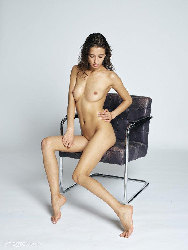 stunning-brunette-hottie-presents-her-perfect-body-on-the-armchair-15-w800
