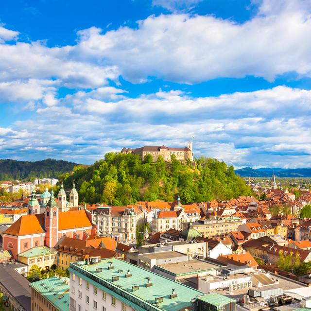 Panorama of the vibrant Slovenian capital Ljubljana in afternoon sun.jpg