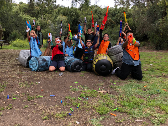 Group pose for a photo before a Nerf War Party on May 18 in Los Angeles