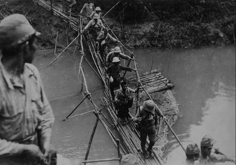 Japanese soldiers overcome the river.