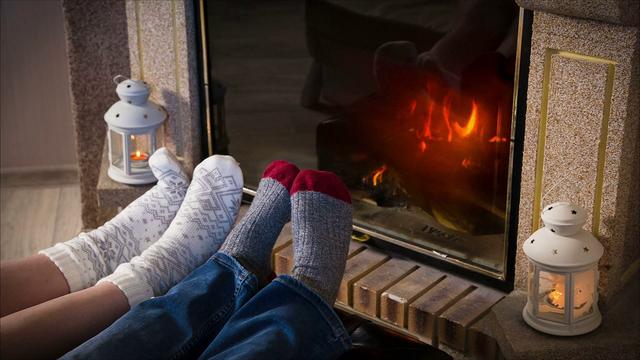 legs-in-woolen-socks-heat-up-near-fireplace-bbi20pr-x-thumbnail-full01.png