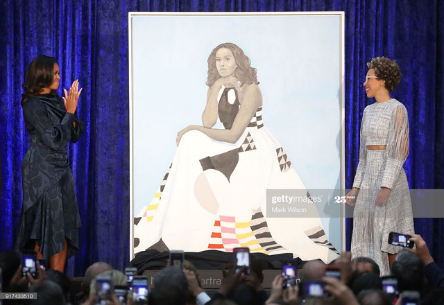 WASHINGTON-DC-FEBRUARY-12-Former-U-S-first-lady-Michelle-Obama-L-and-artist-Amy-Sherald-unveil-her-p.jpg