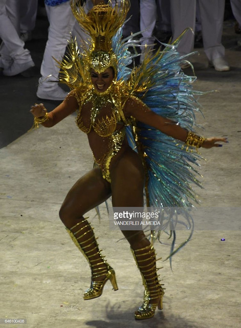 A-reveller-of-the-Portela-samba-school-performs-on-the-second-night-of-Rio-s-Carnival-at-the-Sambadr
