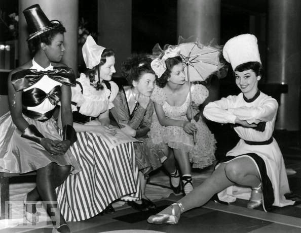 Audrey-Hepburn-with-the-cast-of-a-Christmas-Party-1949