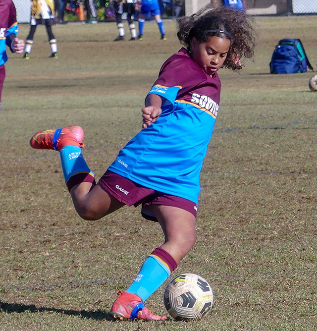 Zahra Ahmed - In action playing soccer