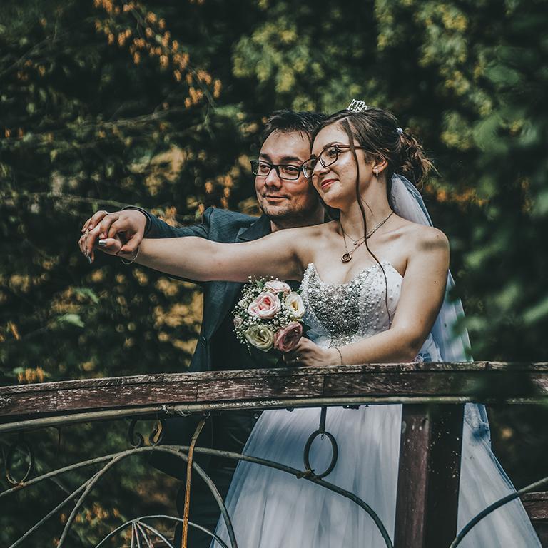 Mirnes and Edina holding hands on wooden bridge