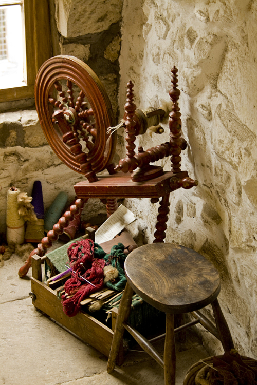 An image of a spinning wheel, representative of spinning in folklore.