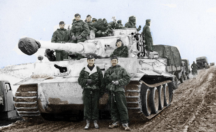 Otto Carius (left) and his Tiger tank before being sent to the front