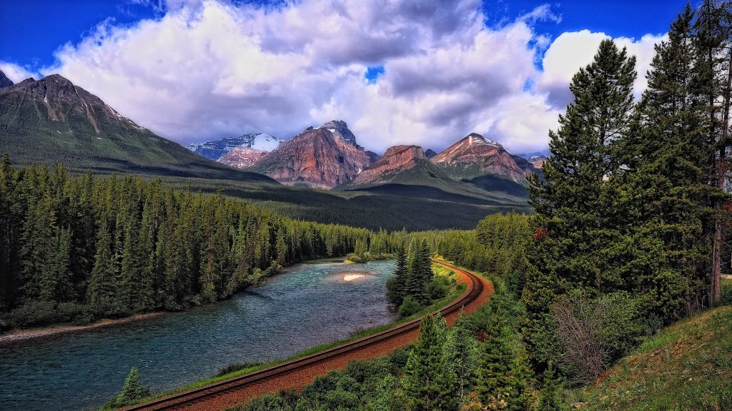 [Image: Landscape-mountains-railroad-sky-trees-4...24x576.jpg]