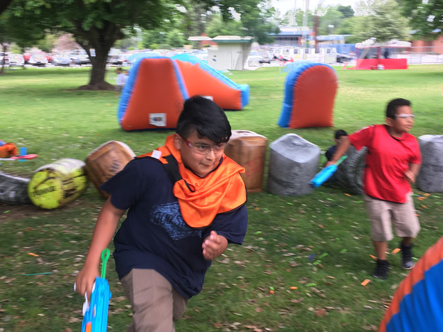 Child running for cover during Nerf Gun Party on May 18 in Asuza