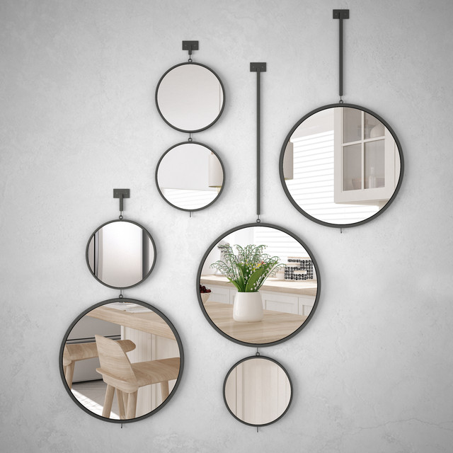 Round-mirrors-hanging-on-the-wall-reflecting-interior-design-scene-minimalist-white-kitchen-modern-a