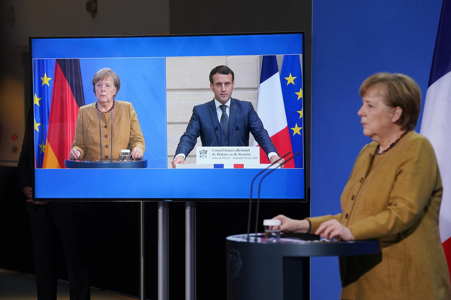 epa08989545-German-Chancellor-Angela-Merkel-R-and-French-President-Emmanuel-Macron-who-is-tuning-in-