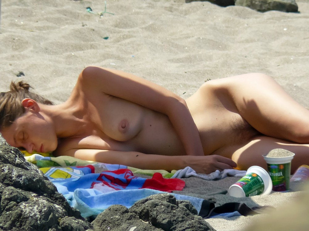 Teenage girls topless sunbathing