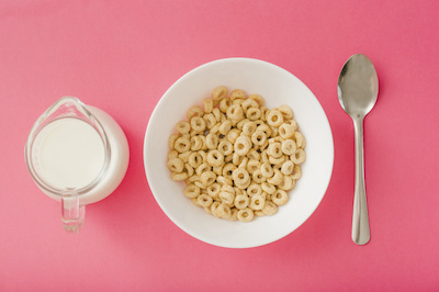 pitcher-milk-bowl-cereals-spoon-red-background-23-2147872655