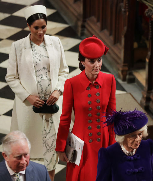 Britain-s-Kate-Duchess-of-Cambridge-and-Meghan-Duchess-of-Sussex-leave-after-attending-the-Commonwea.jpg