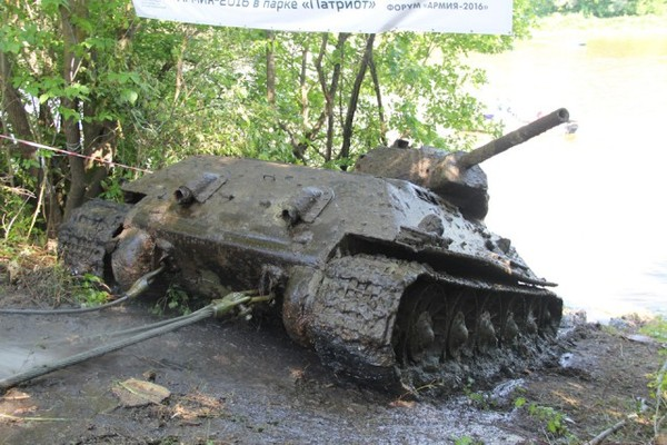 The process of extracting from the water/swamp an found abandoned rare Soviet tank T34-76