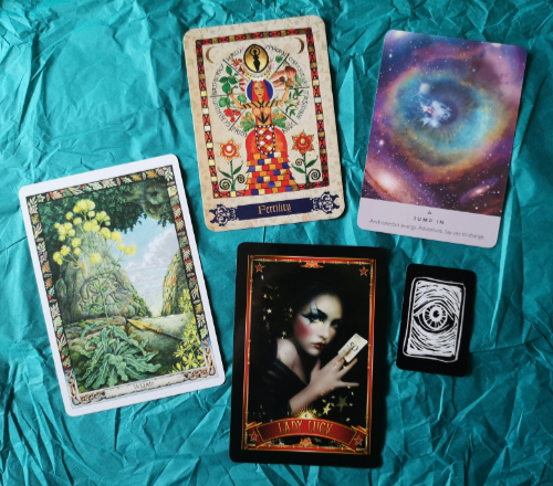 An image of a range of oracle cards.